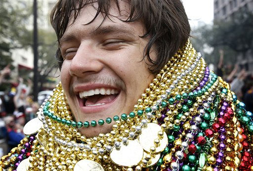 Lee Chance laughs as he shows off his collection of beads that he caught during the Zulu Social Aid and Pleasure Club parade in New Orleans on Mardi Gras Day, Tuesday, March 8, 2011. &#40;AP Photo&#47;Patrick Semansky&#41; <span class=meta>(AP Photo&#47; Patrick Semansky)</span>