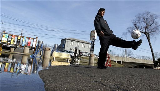 Roland Hernandez, 20, uses down time at Willowbrook Car Wash by dribbling a soccer ball as flood waters surrounded the establishment forcing a slow work day, Tuesday, March 8, 2011, in Wayne, N.J. The accumulated water was caused by the Passaic River overflowing its banks after a storm hit late Sunday night. &#40;AP Photo&#47;Julio Cortez&#41; <span class=meta>(AP Photo&#47; Julio Cortez)</span>
