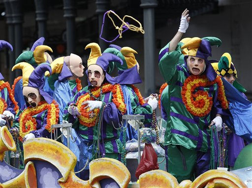 Members of the Krewe of Rex throw beads on Canal St. on Mardi Gras day in New Orleans, Tuesday, March 8, 2011. &#40;AP Photo&#47;Gerald Herbert&#41; <span class=meta>(AP Photo&#47; Gerald Herbert)</span>