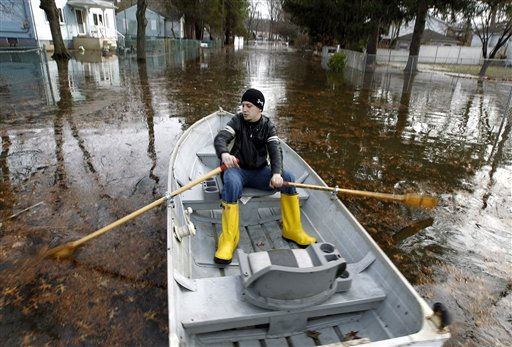 Guy Steffy, 24, rows his boat on his way to pick up a friend as flood waters from the Passaic River cover Riverside Drive, Tuesday, March 8, 2011, in Wayne, N.J. &#40;AP Photo&#47;Julio Cortez&#41; <span class=meta>(AP Photo&#47; Julio Cortez)</span>
