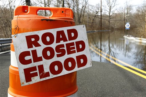 A road block is seen as high waters from the Passaic River cover Fairfield Road, Tuesday, March 8, 2011, in Fairfield, N.J. &#40;AP Photo&#47;Julio Cortez&#41; <span class=meta>(AP Photo&#47; Julio Cortez)</span>