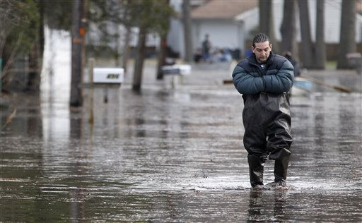 Eric Labrador, 25, wades through flood waters caused by the Passaic River overflowing its banks, Tuesday, March 8, 2011, in Wayne, N.J. &#40;AP Photo&#47;Julio Cortez&#41; <span class=meta>(AP Photo&#47; Julio Cortez)</span>