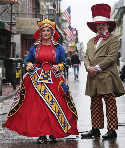 "<div class=""meta image-caption""><div class=""origin-logo origin-image ""><span></span></div><span class=""caption-text"">Jenny Tell and Richard Harris wearing their Mardi Gras costume walk through the French Quarter helping to celebrate the Mard Gras in New Orleans, Tuesday, March 8, 2011.  (AP Photo/Bill Haber) (AP Photo/ Bill Haber)</span></div>"