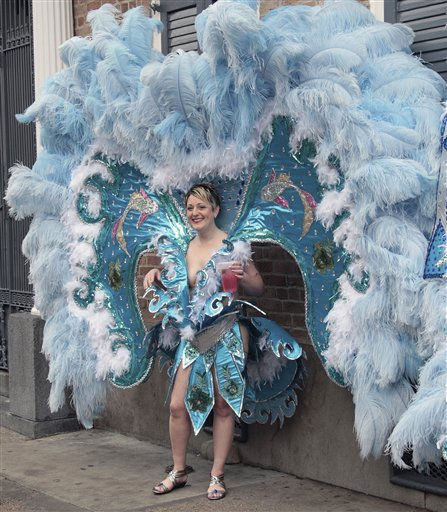 A costumed reveler enjoys the Mardi Gras celebration in the French Quarter of New Orleans, Tuesday, March 8, 2011.  &#40;AP Photo&#47;Bill Haber&#41; <span class=meta>(AP Photo&#47; Bill Haber)</span>
