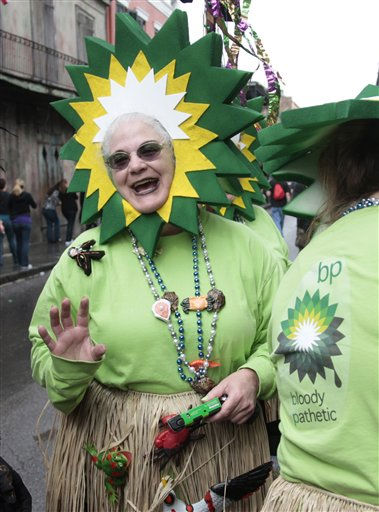 R.M. Elfer, of New Orleans costumed as an BP emblem enjoy the Mardi Gras celebration in the French Quarter of New Orleans, Tuesday, March 8, 2011.  &#40;AP Photo&#47;Bill Haber&#41; <span class=meta>(AP Photo&#47; Bill Haber)</span>