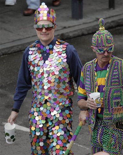 A Mardi Gras Revelers dressed in a suit of doubloons and beads poses for a photograph  as he enjoys the Mardi Gras celebration in the French Quarter of New Orleans, Tuesday, March 8, 2011.  &#40;AP Photo&#47;Bill Haber&#41; <span class=meta>(AP Photo&#47; Bill Haber)</span>