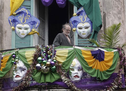A man looks down from his apartment on the crowds celebrating  the Mardi Gras in the French Quarter of New Orleans, Tuesday, March 8, 2011.  &#40;AP Photo&#47;Bill Haber&#41; <span class=meta>(AP Photo&#47; Bill Haber)</span>