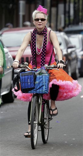 Linda Lachin, of New Orleans,, adjusts her costume while riding her bike to the Mardi Gras celebration in the French Quarter of New Orleans, Tuesday, March 8, 2011.  &#40;AP Photo&#47;Bill Haber&#41; <span class=meta>(AP Photo&#47; Bill Haber)</span>