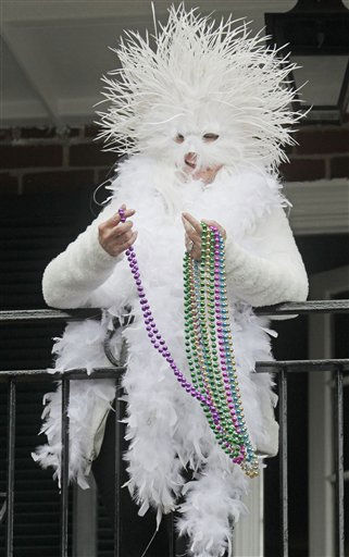 A Mardi Gras reveler throws beads from a balcony while  enjoying the Mardi Gras celebration in the French Quarter of New Orleans, Tuesday, March 8, 2011.  &#40;AP Photo&#47;Bill Haber&#41; <span class=meta>(AP Photo&#47; Bill Haber)</span>