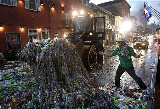 Mardi Gras reveler Mike Turpin, whose night still isn&#39;t over, reacts as a front loader collects beads and other debris left behind by revelers on Bourbon Street in the French Quarter of New Orleans, early Wednesday, March 9, 2011. Ash Wednesday marks the end of Mardi Gras festivities and the beginning of the Lenten season for Catholics. &#40;AP Photo&#47;Patrick Semansky&#41; <span class=meta>(AP Photo&#47; Patrick Semansky)</span>