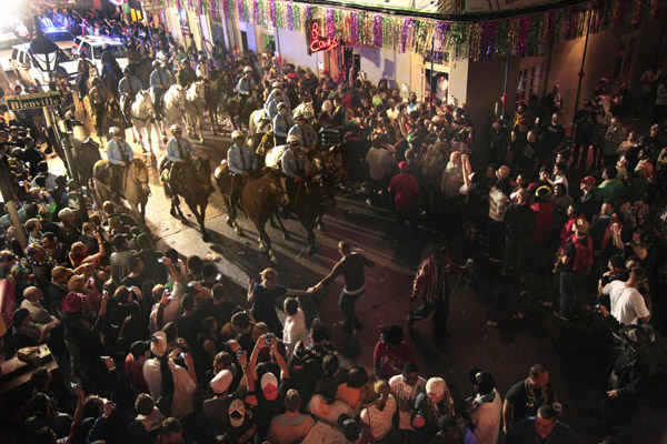 Police on horseback and foot clear out the crowds on Bourbon Street at midnight for the end of Mardi Gras festivities in New Orleans, Wednesday, March 9, 2011. &#40;AP Photo&#47;Gerald Herbert&#41; <span class=meta>(Photo&#47;Gerald Herbert)</span>