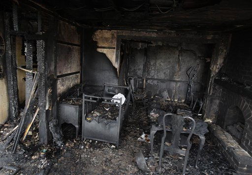 A crib and other pieces of furniture sit inside of the fire-ravaged farmhouse of Theodore and Janelle Clouse on Wednesday, March 9, 2011, in Loysville, Pa. Seven Clouse children including a 7-month-old infant perished in a fast-moving fire Tuesday night, while their mother milked cows and their father dozed in a milk truck down the road. &#40;AP Photo&#47;Carolyn Kaster&#41; <span class=meta>(AP Photo&#47; Carolyn Kaster)</span>