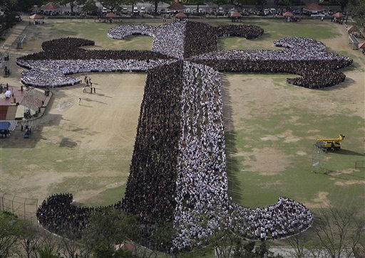 Filipino students, employees, administrators and seminarians from the University of Santo Tomas &#40;UST&#41; gather to form a &#34;Dominican Cross&#34; as they observe the start of Lent on Ash Wednesday on March 9, 2011, inside the UST campus in Manila, Philippines. Organizers claimed to have more than 20,000 participants during the event and will attempt to the break the &#34;Guinness World Record&#34; as the &#34;Largest Human Cross.&#34; &#40;AP Photo&#47;Aaron Favila&#41; <span class=meta>(AP Photo&#47; Aaron Favila)</span>