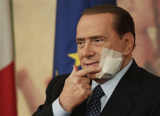 Italian Premier Silvio Berlusconi touches his face during a press conference following a cabinet meeting on the justice reforms, in Rome, Thursday, March 10, 2011. Berlusconi has an adhesive bandage on his face after undergoing jaw surgery earlier this week. &#40;AP Photo&#47;Andrew Medichini&#41; <span class=meta>(AP Photo&#47; Andrew Medichini)</span>