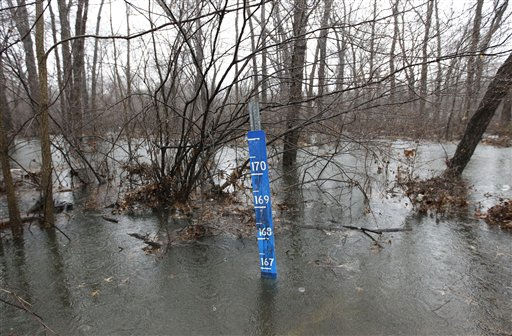 A flood gage is seen in a remote area where water from the Pompton River has gone over its banks during a storm, Thursday, March 10, 2011, in Lincoln Park, N.J. &#40;AP Photo&#47;Julio Cortez&#41; <span class=meta>(AP Photo&#47; Julio Cortez)</span>
