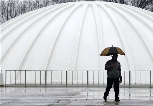 A person carries an umbrella in a light rainfall while walking near the planetarium at the New Jersey State Museum Thursday, March 10, 2011, in Trenton, N.J. Flood watches are in effect across much of New Jersey as rain moves into the state, threatening to raise already swollen waterways out of their banks. &#40;AP Photo&#47;Mel Evans&#41; <span class=meta>(AP Photo&#47; Mel Evans)</span>