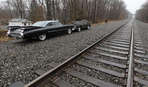 Vehicles are seen parked on higher grounds along NJ Transit tracks as residents prepared from an expected flooding on the Pompton River during a storm, Thursday, March 10, 2011, in Lincoln Park, N.J. &#40;AP Photo&#47;Julio Cortez&#41; <span class=meta>(AP Photo&#47; Julio Cortez)</span>