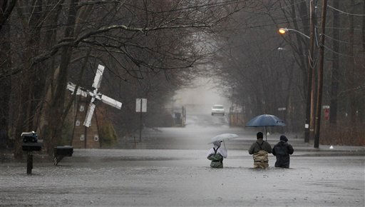 People make their way down flood waters on Lincoln Boulevard as rain comes down over them, Thursday, March 10, 2011, in Lincoln Park, N.J. &#40;AP Photo&#47;Julio Cortez&#41; <span class=meta>(AP Photo&#47; Julio Cortez)</span>
