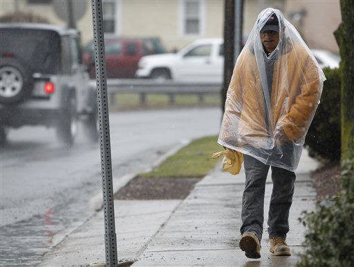 Antonio Rivas uses a bag as a rain cover as he walks home from work during a rain storm, Thursday, March 10, 2011, in Little Falls, N.J. &#40;AP Photo&#47;Julio Cortez&#41; <span class=meta>(AP Photo&#47; Julio Cortez)</span>