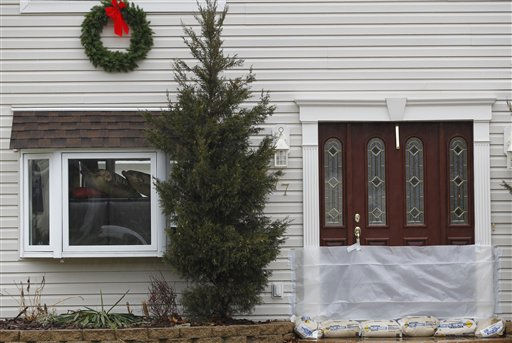 "<div class=""meta ""><span class=""caption-text "">A house is seen with plastic and sandbags at the front door and furniture near the window as residents prepare for a possible flood, Thursday, March 10, 2011, in Pequannock, N.J. (AP Photo/Julio Cortez) (AP Photo/ Julio Cortez)</span></div>"