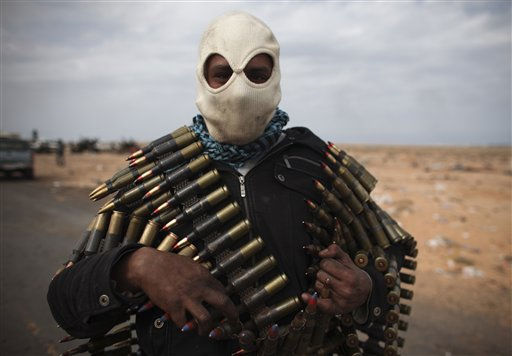 A Libyan volunteer carries ammunition on the outskirts of the eastern town of Ras Lanouf, Libya, Thursday, March 10, 2011. Government forces drove hundreds of rebels from a strategic oil port with rockets and tank shells on Thursday, significantly expanding Moammar Gadhafi&#39;s control of Libya. &#40;AP Photo&#47;Tara Todras-Whitehill&#41; <span class=meta>(AP Photo&#47; Tara Todras-Whitehill)</span>