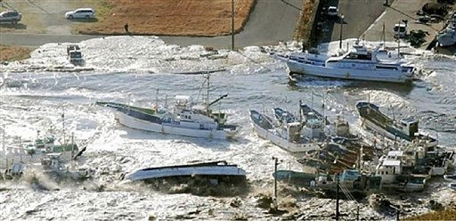 Fishing boats are damaged in Asahi, Chiba prefecture &#40;state&#41;, Japan, after a ferocious tsunami unleashed by Japan&#39;s biggest recorded earthquake slammed into its eastern coast Friday, Friday, March 11, 2011. &#40;AP Photo&#47;The Yomiuri Shimbun&#41; JAPAN OUT, CREDIT MANDATORY <span class=meta>(AP Photo&#47; Anonymous)</span>