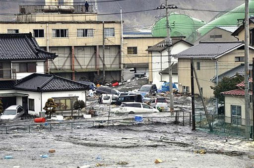 "<div class=""meta image-caption""><div class=""origin-logo origin-image ""><span></span></div><span class=""caption-text"">An earthquake-triggered tsunami washes away a warehouse and vehicles in Kesennuma, Miyagi prefecture (state), Japan,  Friday March 11, 2011. The ferocious tsunami spawned by one of the largest earthquakes ever recorded slammed Japan's eastern coasts. (AP Photo/The Yomiuri Shimbun) JAPAN OUT, CREDIT MANDATORY (AP Photo/ Anonymous)</span></div>"