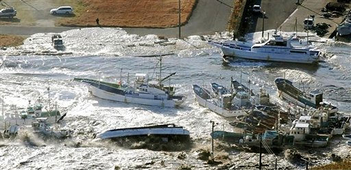 RETRANSMISSION WITH BETTER QUALITY - Fishing boats are damaged in Asahi, Chiba prefecture &#40;state&#41;, Japan, after a ferocious tsunami unleashed by Japan&#39;s biggest recorded earthquake slammed into its eastern coast Friday, Friday, March 11, 2011. &#40;AP Photo&#47;The Yomiuri Shimbun&#41; JAPAN OUT, CREDIT MANDATORY <span class=meta>(AP Photo&#47; Anonymous)</span>