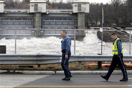 Pompton Lakes officials walk across a bridge near the Ramapo River flood gate in Wayne, N.J., as water levels continued to rise following a storm that hit the northern New Jersey region, Friday, March 11, 2011. &#40;AP Photo&#47;Julio Cortez&#41; <span class=meta>(AP Photo&#47; Julio Cortez)</span>