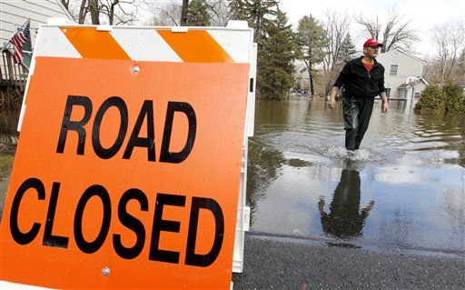 "<div class=""meta ""><span class=""caption-text "">George Ruby, of the Riverview Community in Wayne, N.J., wades through water on his street, Friday, March 11, 2011. The water levels rose Friday morning, following a storm that hit the northern New Jersey region. (AP Photo/Julio Cortez) (AP Photo/ Julio Cortez)</span></div>"
