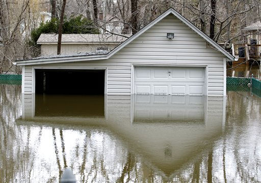 High waters from the Pompton River surround a garage in the Riverview Community in Wayne, N.J. on Friday, March 11, 2011. Water levels rose Friday morning following a storm that hit the northern New Jersey region. &#40;AP Photo&#47;Julio Cortez&#41; <span class=meta>(AP Photo&#47; Julio Cortez)</span>