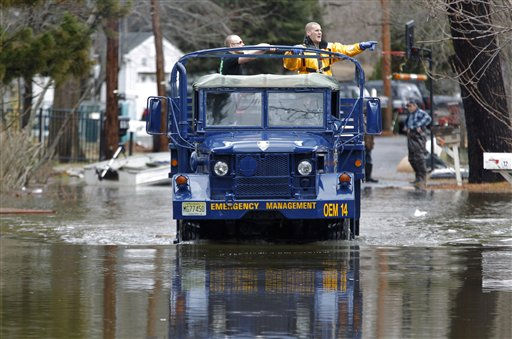 Members of the Wayne Police Department survey the Riverview Community in Wayne, N.J., following a storm that brought flood waters from the Pompton River on Friday, March 11, 2011. &#40;AP Photo&#47;Julio Cortez&#41; <span class=meta>(AP Photo&#47; Julio Cortez)</span>