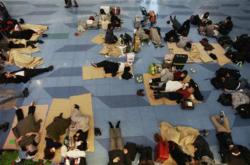 "<div class=""meta image-caption""><div class=""origin-logo origin-image ""><span></span></div><span class=""caption-text"">Travelers rest on the floor stranded at the Haneda international airport in Tokyo after a massive earthquake Friday, March 11, 2011. The ferocious tsunami spawned by one of the largest earthquakes ever recorded slammed Japan's eastern coasts. (AP Photo/Wally Santana) (AP Photo/ Wally Santana)</span></div>"