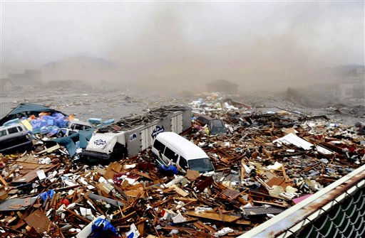 "<div class=""meta image-caption""><div class=""origin-logo origin-image ""><span></span></div><span class=""caption-text"">Cars and other Debris swept away by tsunami tidal waves are seen in Kesennuma in Miyagi Prefecture, northern Japan, after strong earthquakes hit the area Friday, March 11, 2011. (AP Photo/Keichi Nakane, The Yomiuri Shimbun)  JAPAN OUT, CREDIT MANDATORY (AP Photo/ Keichi Nakane)</span></div>"