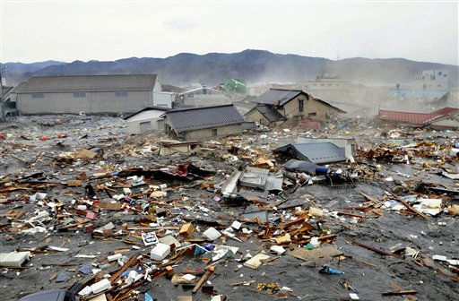 Houses, cars and other debris are washed away by tsunami tidal waves in Kesennuma in Miyagi Prefecture, northern Japan, after strong earthquakes hit the area Friday, March 11, 2011. &#40;AP Photo&#47;Keichi Nakane, The Yomiuri Shimbun&#41;  JAPAN OUT, CREDIT MANDATORY <span class=meta>(AP Photo&#47; Keichi Nakane)</span>