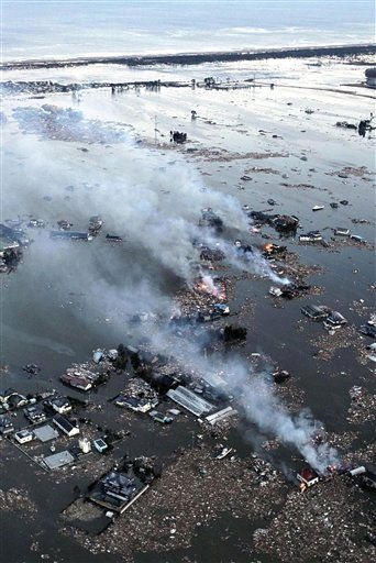 "<div class=""meta image-caption""><div class=""origin-logo origin-image ""><span></span></div><span class=""caption-text"">An aerial view shows houses burning and the Natori River flooded over the surrounding area in Natori, northern Japan, Friday, March 11, 2011. The largest earthquake in Japan's recorded history slammed the eastern coasts Friday. (AP Photo/Yasushi Kanno, The Yomiuri Shimbun) JAPAN OUT, CREDIT MANDATORY (AP Photo/ Yasushi Kanno)</span></div>"