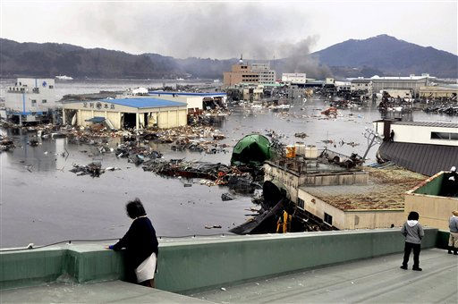 An earthquake-triggered tsunami washes away a warehouse and vehicles in Kesennuma, Miyagi prefecture &#40;state&#41;, Japan,  Friday March 11, 2011. The ferocious tsunami spawned by one of the largest earthquakes ever recorded slammed Japan&#39;s eastern coasts. &#40;AP Photo&#47;The Yomiuri Shimbun, Keiichi Nakane&#41; JAPAN OUT, CREDIT MANDATORY <span class=meta>(AP Photo&#47; Keiichi Nakane)</span>