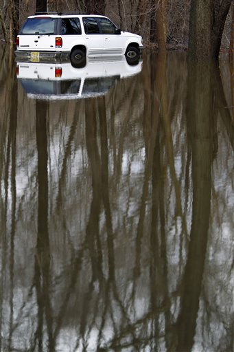 High water from the Pompton River reflects trees and a parked car at the Heritage Manor condominium complex in Wayne, N.J. on Friday, March 11, 2011. The river overflowed its banks following at storm that hit northern New Jersey. &#40;AP Photo&#47;Julio Cortez&#41; <span class=meta>(AP Photo&#47; Julio Cortez)</span>