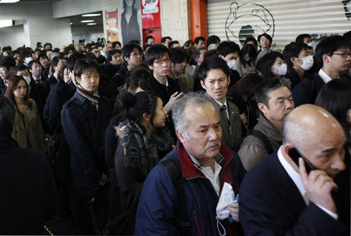 "<div class=""meta image-caption""><div class=""origin-logo origin-image ""><span></span></div><span class=""caption-text"">Commuters wait in a queue at a subway station as train service is delayed after Japan's biggest recorded earthquake slammed into its eastern coast Friday,  in Tokyo, Saturday, March 12, 2011, (AP Photo/Shuji Kajiyama) (AP Photo/ Shuji Kajiyama)</span></div>"