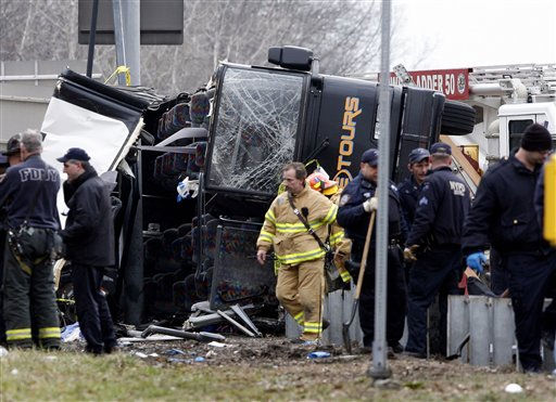 "<div class=""meta ""><span class=""caption-text "">Emergency personnel work at the scene where thirteen people died when a bus returning to New York City from a casino on Saturday, March 12, 2011, overturned on a highway and was sliced in half by the support pole for a large sign. (AP Photo/David Karp) (AP Photo/ David Karp)</span></div>"