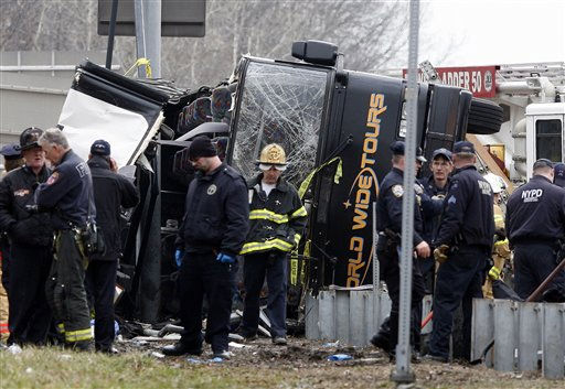 "<div class=""meta image-caption""><div class=""origin-logo origin-image ""><span></span></div><span class=""caption-text"">Emergency personnel investigate the scene of a bus crash on Interstate-95 in the Bronx borough of New York Saturday, March 12, 2011. Thirteen people died when the bus, returning to New York from a casino in Connecticut, flipped onto its side and was sliced in half by the support pole for a large sign. (AP Photo/David Karp) (AP Photo/ David Karp)</span></div>"