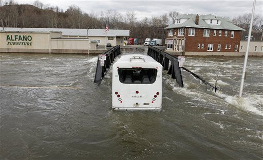 An Express Service bus is seen stuck on a small bridge in downtown Paterson, N.J., where high waters from the Passaic River made the crossing impossible, Sunday, March 13, 2011, in Paterson, N.J. The Passaic River crested overnight following a severe storm that hit the northern New Jersey region. &#40;AP Photo&#47;Julio Cortez&#41; <span class=meta>(AP Photo&#47; Julio Cortez)</span>
