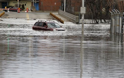 "<div class=""meta ""><span class=""caption-text "">An abandoned vehicle is seen in high water on the Temple Street bridge in downtown Paterson, N.J., where the Passaic River overflowed its banks, Sunday, March 13, 2011. The Passaic River crested overnight following a severe storm that hit the northern New Jersey region. (AP Photo/Julio Cortez) (AP Photo/ Julio Cortez)</span></div>"