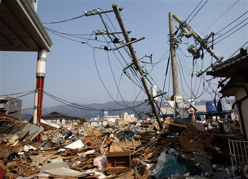 "<div class=""meta image-caption""><div class=""origin-logo origin-image ""><span></span></div><span class=""caption-text"">A motorcyclist passes through the rubble in Ofunato, Iwate Prefecture, northern Japan, Sunday, March 13, 2011, two days after a powerful earthquake-triggered tsunami hit Japan's east coast. (AP Photo/Shizuo Kambayashi) (AP Photo/ Shizuo Kambayashi)</span></div>"