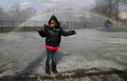 A rainbow is seen over Faith Johnson, 2, as she reacts to mist from the current at Great Falls, Sunday, March 13, 2011, in Paterson, N.J. The falls has been a place for residents looking to witness the intensity of the Passaic River following a severe storm that hit the northern New Jersey region. &#40;AP Photo&#47;Julio Cortez&#41; <span class=meta>(AP Photo&#47; Julio Cortez)</span>