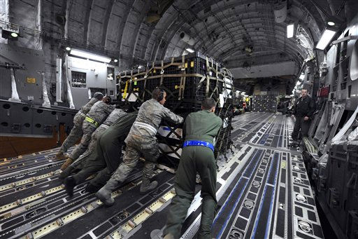 "<div class=""meta image-caption""><div class=""origin-logo origin-image ""><span></span></div><span class=""caption-text"">This image proved by the U.S. Air Force shows airmen loading a pallet onto a U.S. Air Force C-17A Globe Master III, Saturday March 12, 2011 at March Air Reserve Base, Calif. The supplies are enroute to Japan for earthquake relief efforts. (AP Photo/US Air Force - Matthew Smith) (AP Photo/ Staff Sgt. Mathew Smith)</span></div>"