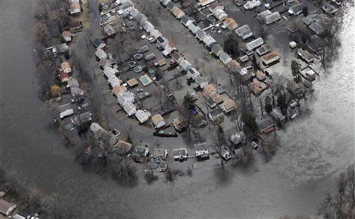 The flooded streets of a community along the Passaic River are seen in an aerial photo, Sunday, March 13, 2011, in Little Falls, N.J. The river overflowed its banks after a severe storm him the northern New Jersey region. &#40;AP Photo&#47;Julio Cortez&#41; <span class=meta>(AP Photo&#47; Julio Cortez)</span>