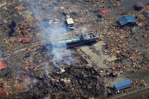 A ship washed away by tsunami sits amid debris in Kesennuma, Miyagi Prefecture, Sunday, March 13, 2011 after Japan&#39;s biggest recorded earthquake hit its eastern coast Friday.  <span class=meta>(AP Photo&#47; Itsuo Inouye)</span>