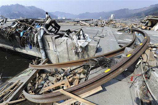 In this photo taken Sunday, March 13, 2011, train rails bent by a powerful earthquake-triggered tsunami get stuck by a bridge in Otsuchicho town, northern Japan, two days after the earthquake hit the country&#39;s east coast. &#40;AP Photo&#47;The Yomiuri Shimbun, Yasuhiro Takami&#41;  <span class=meta>(Photo&#47;Yasuhiro Takami)</span>