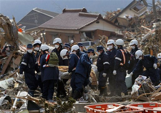 "<div class=""meta image-caption""><div class=""origin-logo origin-image ""><span></span></div><span class=""caption-text"">Police officers carry the body of a victim in Rikuzentakata, Iwate Prefecture, northern Japan, Monday, March 14, 2011, three days after northeastern coastal towns were devastated by an earthquake and tsunami. (AP Photo/Itsuo Inouye) (Photo/Itsuo Inouye)</span></div>"